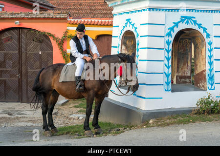 SIBIEL, TRANSYLVANIA/ROMANIA - SEPTEMBER 16 : Young man in traditional dress on a horse in Sibiel Transylvania Romania on September 16, 2018. One unidentified person - Stock Photo