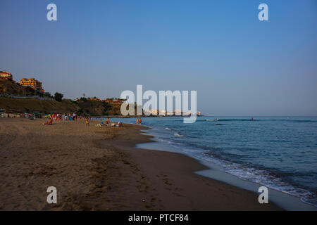 An evening on the beach at Coata del Sol, Fuengirola, Spain. - Stock Photo