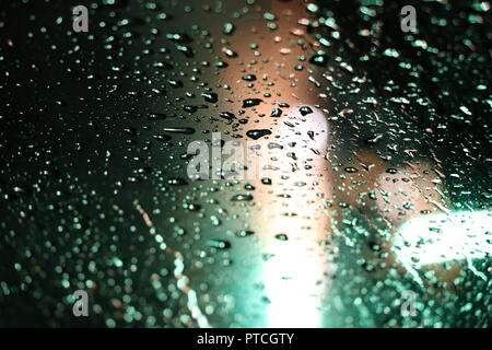 Green Fireworks Reflected Through Water on Glass - Stock Photo