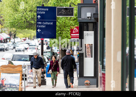 Asheville, USA - April 19, 2018: Downtown old town street in North Carolina NC famous town, city with stores, shops, sign for art gallery, Biltmore, c - Stock Photo