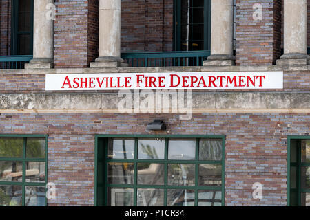 Asheville, USA - April 19, 2018: Downtown old town street in North Carolina NC famous town, city with closeup red sign for fire department emergency s - Stock Photo