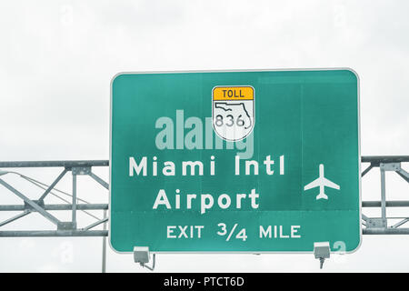Road street highway green sign for Miami International Airport in Florida with exit in a mile, 836 toll turnpike text - Stock Photo