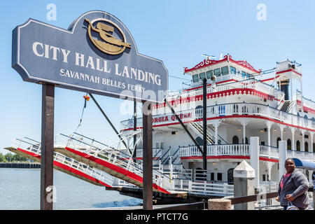 Savannah, USA - May 11, 2018: Old town River street in Georgia famous southern town, city, red Queen cruise ship belles ferry, city hall landing - Stock Photo