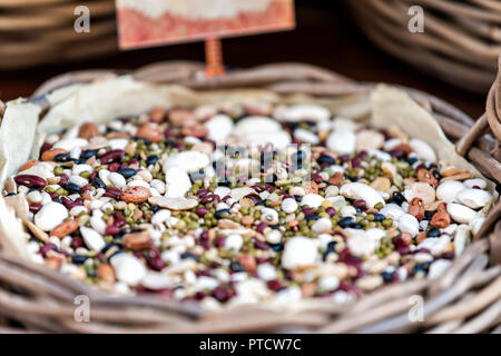 Macro closeup of bean mix in bag for sale in store shop on street town village in Tuscany or Umbria during summer - Stock Photo