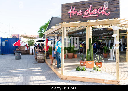 Miami, USA - May 6, 2018: The Deck bar, night club, restaurant with live music in Wynwood art district during summer, sunny weather on street - Stock Photo