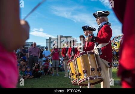 Soldiers with the U.S. Army Old Guard Fife and Drum Corps, assigned to the 3d U.S. Infantry Regiment (The Old Guard), participate in Alexandria City Birthday Celebration at Oronoco Bay Park, Alexandria, Va., July 8, 2017.  Soldiers joined music and entertainment groups in a celebration to honor America's birthday and the 268th birthday of the City of Alexandria. - Stock Photo