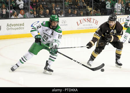 Overtime. 6th Oct, 2018. pursed by Manitoba Bisons forward Jeremey Leipsic (22) in the first period of an exhibition men's college hockey game between the Manitoba Bisons and the University of North Dakota Fighting Hawks at Ralph Engelstad Arena in Grand Forks. North Dakota won 3-2 in overtime. Photo by Russell Hons/CSM/Alamy Live News - Stock Photo