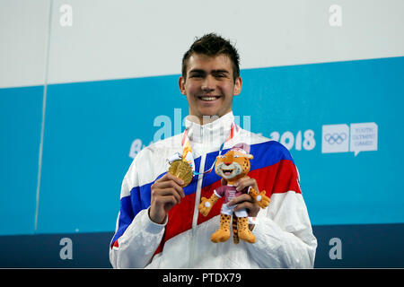 Buenos Aires, Argentina. 08th Oct, 2018. Kliment Kolesnikov, from Russia, celebrates his victory in the 100 metres Backstroke swimming during the Buenos Aires 2018 Youth Olympic Games. Credit: Gustavo Ortiz/dpa/Alamy Live News - Stock Photo