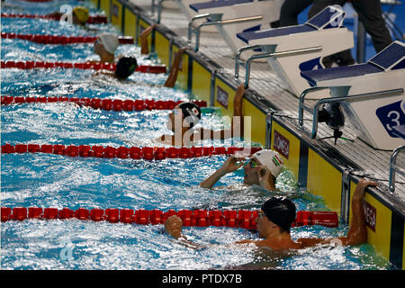 Buenos Aires, Argentina. 08th Oct, 2018. Swimmers watch the results after the 200 metres freestyle swimming finale during the Buenos Aires 2018 Youth Olympic Games. Credit: Gustavo Ortiz/dpa/Alamy Live News - Stock Photo