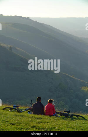 Devils Dyke, Brighton, UK. 9th October 2018. People enjoying the last of the sun on Devils Dyke, in the South Downs National Park, after a warm and sunny day. Credit: Peter Cripps/Alamy Live News - Stock Photo