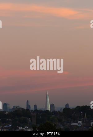 Alexandra Palace, London UK. Tuesday 9th October 2018. UK Weather, pink skies over London during sunset.London skyline with shard. Credit: carol moir/Alamy Live News - Stock Photo