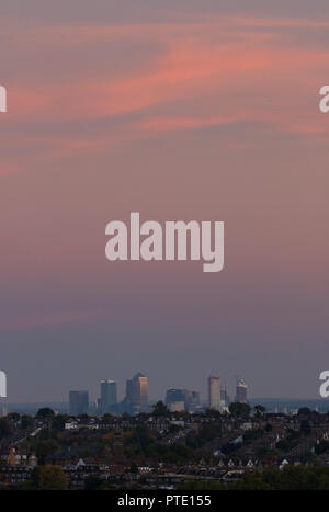 Alexandra Palace, London UK. Tuesday 9th October 2018. UK Weather, pink skies over London during sunset.  Canary Wharf. Credit: carol moir/Alamy Live News - Stock Photo