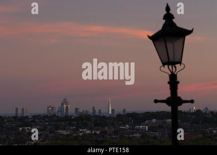 Alexandra Palace, London UK. Tuesday 9th October 2018. UK Weather, pink skies over London during sunset. Credit: carol moir/Alamy Live News - Stock Photo