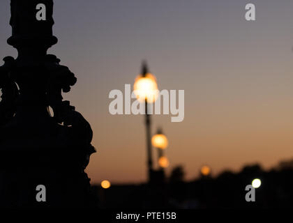 Alexandra Palace, London UK. Tuesday 9th October 2018. UK Weather, pink skies over London during sunset. DEtail from the base of street lamps at Alexandra Palace with more lamps in the background. Credit: carol moir/Alamy Live News - Stock Photo