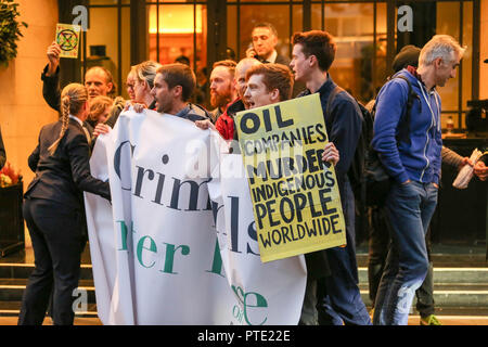 London, UK. 9th Oct, 2018. Protest outside the annual Oil & Money conference, The Dorchester Hotel, Park Lane. Penelope Barritt/Alamy Live News - Stock Photo