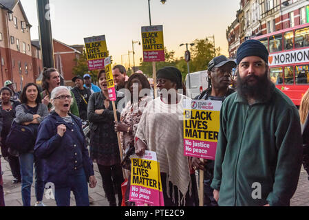 London, UK. October 9th 2018. People at the rally outside the New Atlas Cafe Restaurant where a young black man was attacked by police who used obviously unnecessary force when arresting him on suspicion of having been involved in a knife attack. He was assaulted by six officers, and was viciously kicked while officers struggled to handcuff him, andwhen he was well under control and held on the ground he was sprayed in the face with CS gas. Credit: Peter Marshall/Alamy Live News - Stock Photo