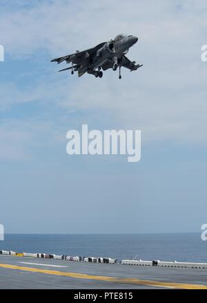 ATLANTIC OCEAN (July 16, 2017) An AV-8B Harrier, attached to the Marine Attack Squadron (VMA-231) 231, lands on the flight deck of the amphibious assault ship USS Wasp (LHD 1). Wasp is currently underway acquiring certifications in preparation for their upcoming homeport shift to Sasebo, Japan where they are slated to relieve the USS Bonhomme Richard (LHD 6) in the 7th Fleet area of operations. - Stock Photo