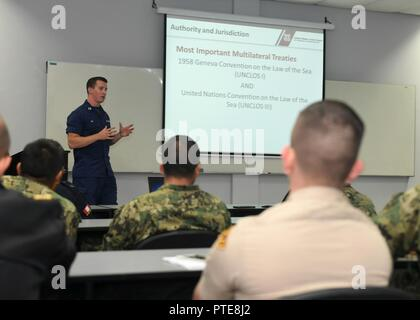 Peru (July 16, 2917) - U.S. Coast Guard Lt. Andrew Ray conducts a maritime law enforcement symposium with UNITAS partner nation participants from Mexico, Peru, Honduras and Chile. UNITAS is an annual exercise that focuses on strengthening our existing regional partnerships and encourages establishing new relationships through the exchange of maritime mission-focused knowledge and expertise throughout the exercise. - Stock Photo