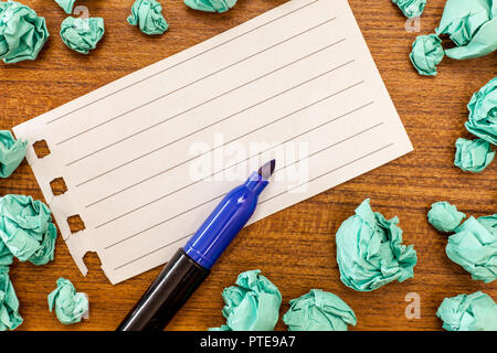 Design business concept Empty template copy space text for Ad website isolated. Blank Torn Notebook Page Marker Pen Crumpled Color Paper on Wood Surfa - Stock Photo