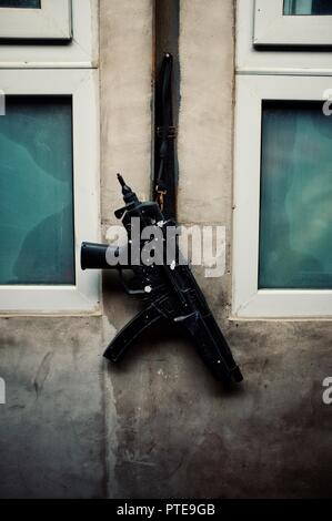 gun hanging outside of a kitchen window - Stock Photo