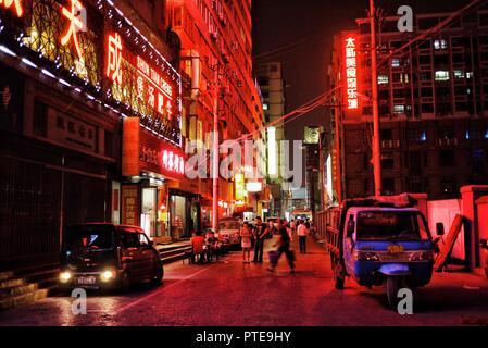 Beijing / China - JUN 24 2011: night street city scene with strong neon lights