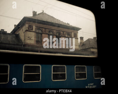 railway station at the rural part of Hungary at the district capital city of Kaposvar on a rather rainy and hazy day - Stock Photo
