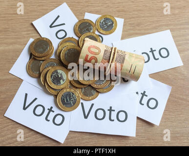 'Voto' (in portuguese: Vote), political corruption in Brazil and the purchase of votes in elections. In a concept image. - Stock Photo