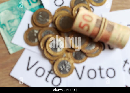 'Voto' (in portuguese: Vote), abstract defocused on political corruption in Brazil and the purchase of votes in elections. - Stock Photo