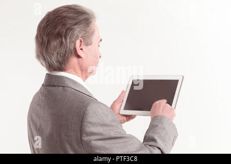close up.the businessman points to the tablet screen.rear view.isolated on white background - Stock Photo