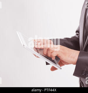 close up.businessman tapping on the screen of digital tablet - Stock Photo