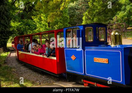 England, Berkshire,  Lower Basildon, Beale Park Wildlife Park & Gardens, passengers on narrow gauge miniature train pulled by diesel loco Howard - Stock Photo