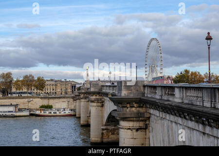 Paris, France - November 2017: the Concorde bridge and the Big Wheel   area listed as World Heritage by UNESCO. Paris, France - Stock Photo