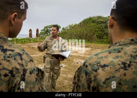 New Zealand Army Sgt. Maj. Paul Buckley, company sergeant major for delta company, explains to U.S. Marines with 3rd Battalion 4th Marines attached to Task Force Koa Moana 17, weapon safety rules prior to participating on a live fire range during Exercise TAFAKULA, on Tongatapu Island, Tonga, July 21, 2017. Exercise TAFAKULA is designed to strengthen the military-to-military, and community relations between Tonga's His Majesty's Armed Forces, French Army of New Caledonia, New Zealand Defense Force, and the United States Armed Forces.