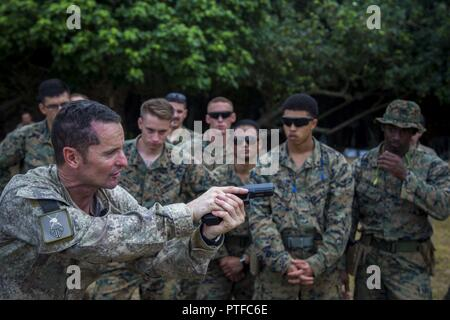New Zealand Army Sgt. Maj. Paul Buckley, company sergeant major for delta company, shows U.S. Marines with 3rd Battalion 4th Marines attached to Task Force Koa Moana 17, how to use the glock 17 weapon system during Exercise TAFAKULA, on Tongatapu Island, Tonga, July 21, 2017. Exercise TAFAKULA is designed to strengthen the military-to-military, and community relations between Tonga's His Majesty's Armed Forces, French Army of New Caledonia, New Zealand Defense Force, and the United States Armed Forces.