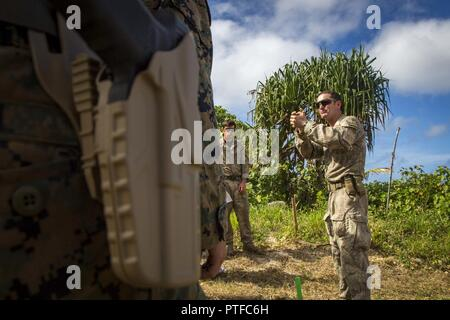 New Zealand Army Sgt. Maj. Paul Buckley, company sergeant major for delta company, shows U.S. Marines with 3rd Battalion 4th Marines attached to Task Force Koa Moana 17, how to properly hold the glock 17 during Exercise TAFAKULA, on Tongatapu Island, Tonga, July 21, 2017. Exercise TAFAKULA is designed to strengthen the military-to-military, and community relations between Tonga's His Majesty's Armed Forces, French Army of New Caledonia, New Zealand Defense Force, and the United States Armed Forces.
