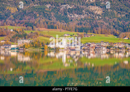 Beautiful view of popular touristic alpine town St. Wolfgang on Wolfgangsee lake in Austria. Beautiful sunny autumn day, clear waters of Wolfgangsee l - Stock Photo