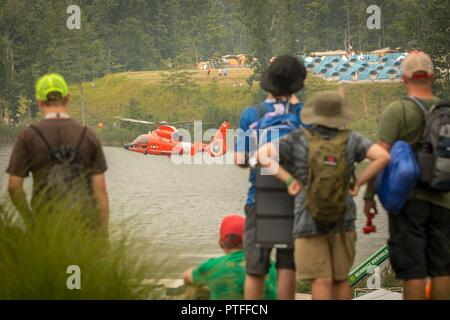 Scouts watch as U S  Coast Guardsmen demonstrate a water rescue