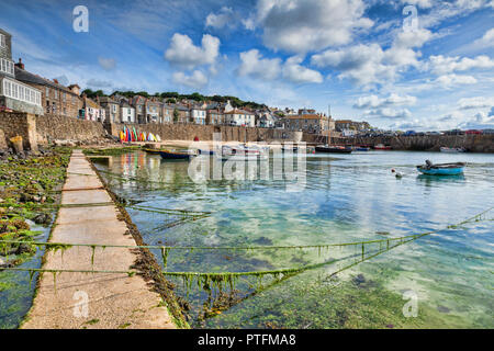 15 June 2018: Mousehole, Cornwall, UK - The harbour and village on a bright summer day. - Stock Photo