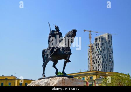 statue of skanderbeg on horseback in skanderbeg square tirana albania with new skyscraper building and crane - Stock Photo