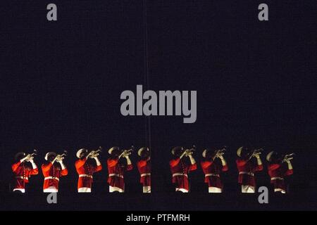 U.S. Marines with the Marine Corps Drum and Bugle Corps perform during an evening parade at Marine Barracks Washington, Washington, D.C., July 21, 2017. Evening parades are held as a means of honoring senior officials, distinguished citizens and supporters of the Marine Corps. - Stock Photo