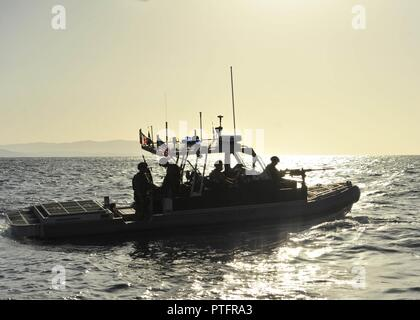 Coast Guardsmen from Port Security Unit 305 aboard a 32-foot Transportable Port Security Boat enforce a security zone off the coast of Naval Station Guantanamo Bay, Cuba, Wednesday, July 19, 2017. PSU 305 is deployed to Naval Station Guantanamo Bay to provide mission support for the Department of Defense. U.S. Coast Guard - Stock Photo
