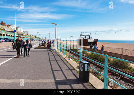 Brighton, England, October 07, 2018. People walking from Brighton Marina to the pier, view of the sea, shingle beach, selective focus - Stock Photo