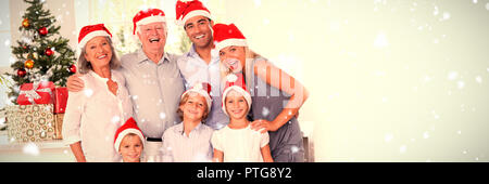 Composite image of family posing for photo - Stock Photo