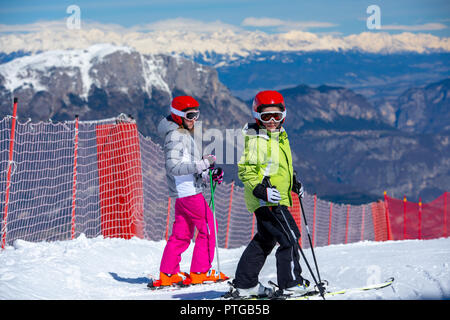 Happy children ready for skiing in the high mountains - Stock Photo