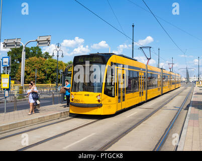 A modern yellow tram in Budapest, Hungary - Stock Photo