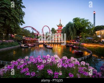 Copenhagen. Denmark. Tivoli Gardens amusement park. Dragon boat lake and the Chinese tower. - Stock Photo