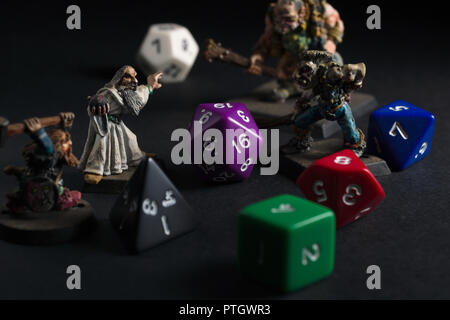 Dungeons and Dragons dice and hand painted lead figures produced by Games Workshop in 1983 as accessories to the game - Stock Photo