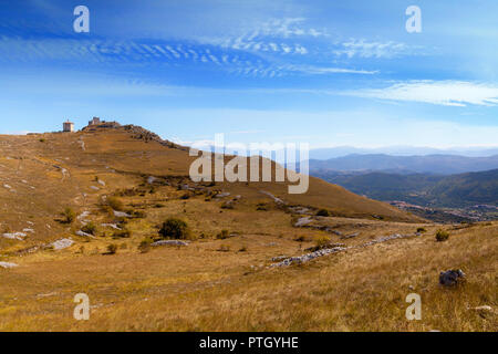 A distant view of 10th Century Rocca Calascio, a mountaintop fortress in the Province of L'Aquila in Abruzzo, Italy. - Stock Photo