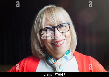 Portrait smiling, confident senior woman - Stock Photo