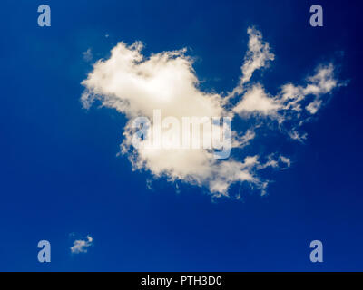 White clouds on blue sky background in sunny day summer time - Stock Photo